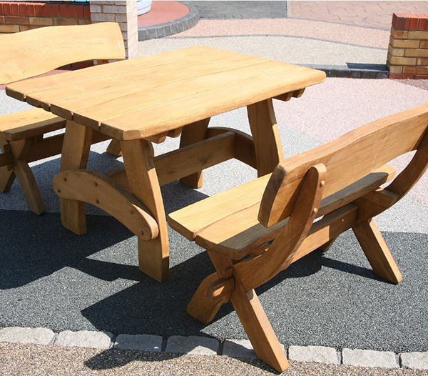 oak table set. comes with two benches. Bespoke outdoor furniture from solid oak