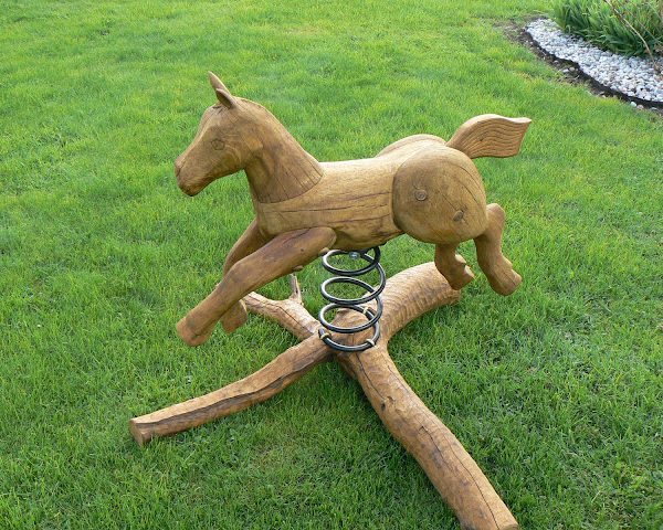 Rustic company wooden horse swing left