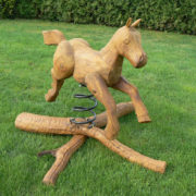 Rustic company wooden horse swing